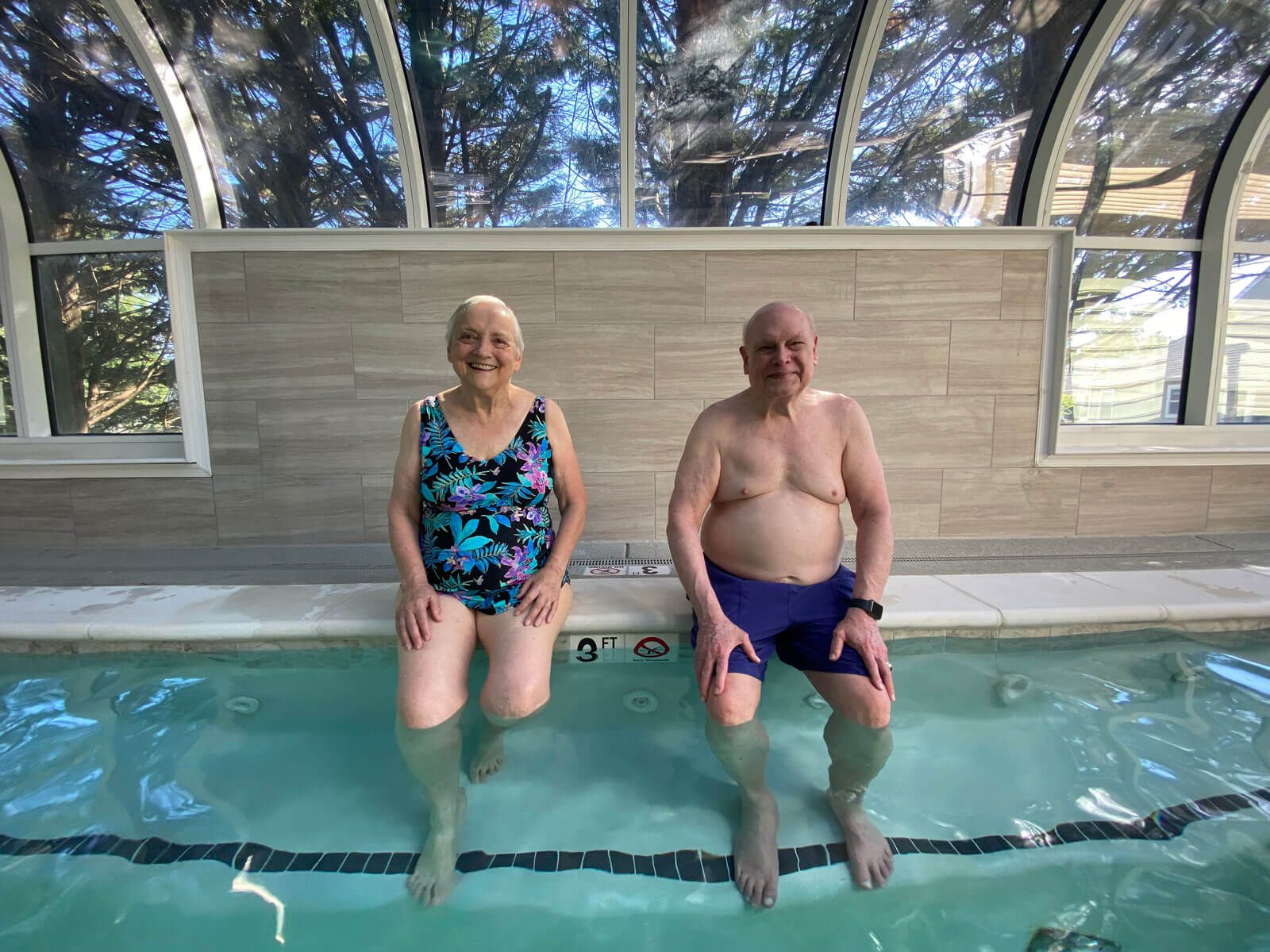 couple wading in pool