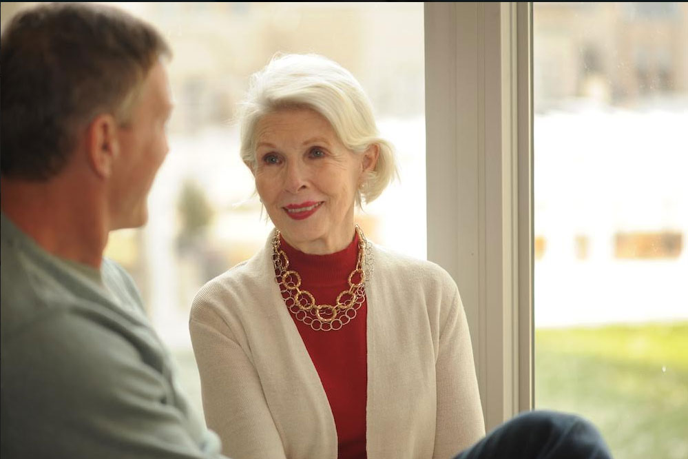 woman looking at adult son