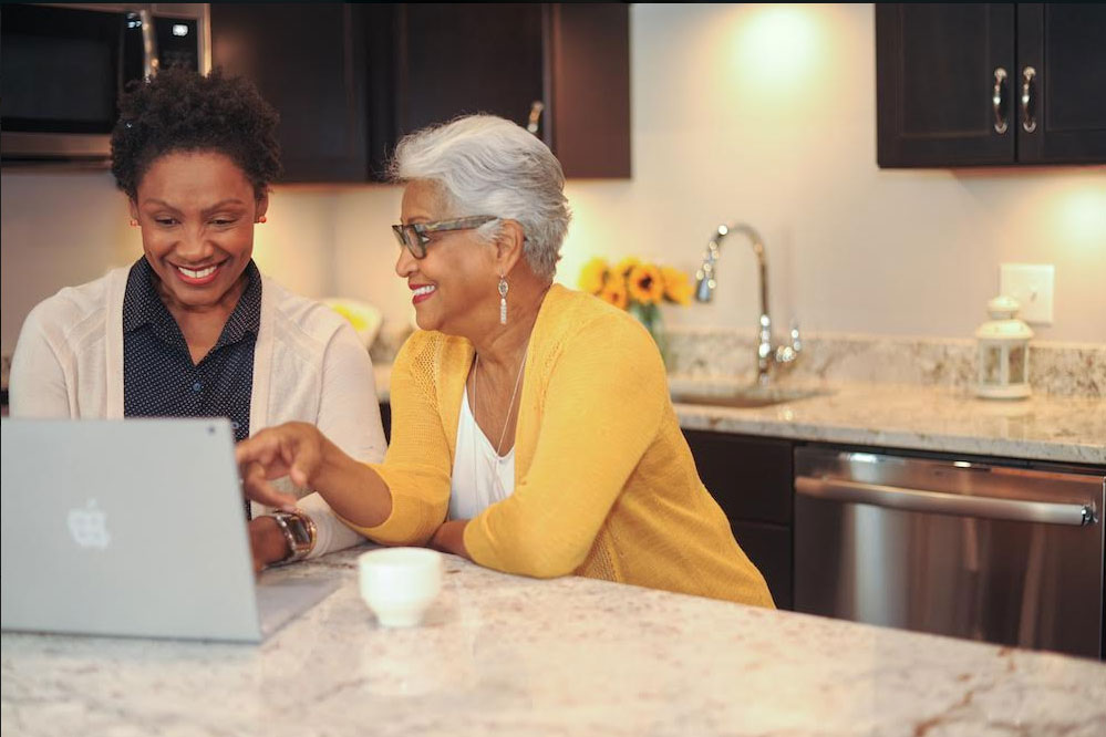 woman and daughter on laptop